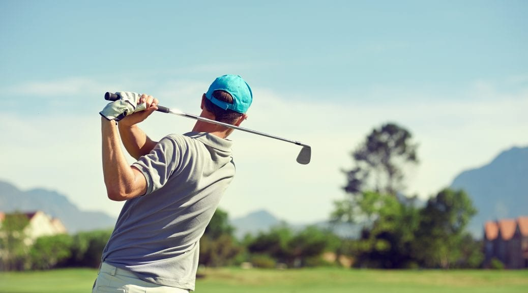 Shoulder pain while golfing; Golfer hitting golf shot with club on course while on summer vacation