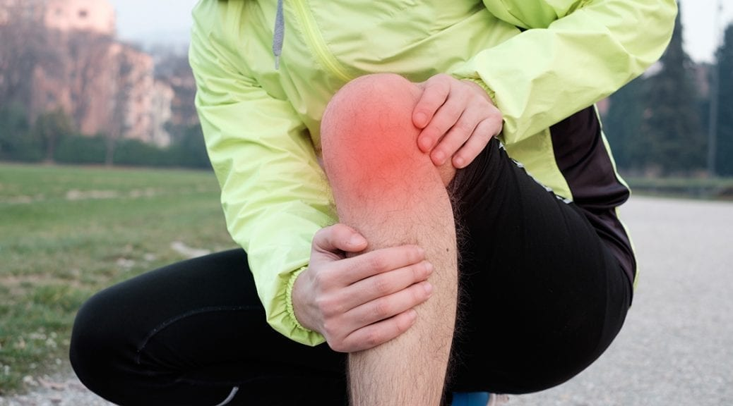 Runner with injured ankle while training in the city park in cold weather; blog: Tips for Relieving Joint Pain in Winter