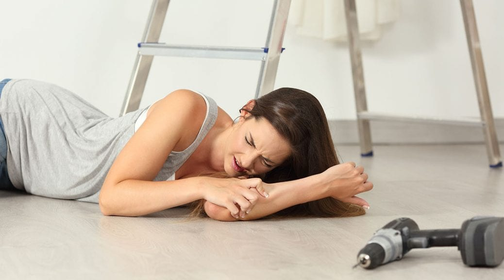 Woman complaining after domestic accident on the floor at home; blog: How to Avoid 5 Common Household Injuries