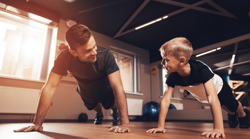 Father and son in the gym together